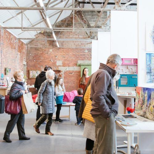Busy art exhibition at Sunny Bank Mills, Yorkshire