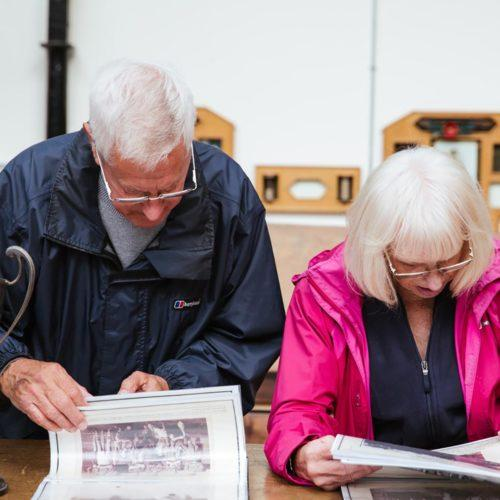 People viewing art at Sunny Bank Mills