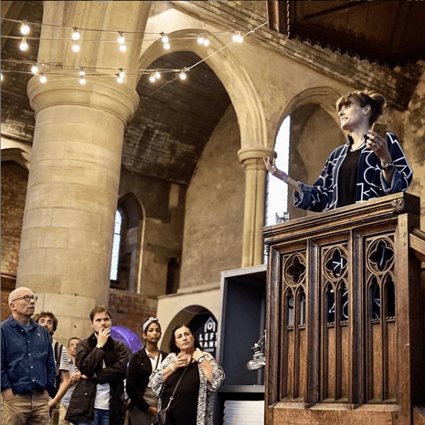 Courtney Spencer delivering talk in church